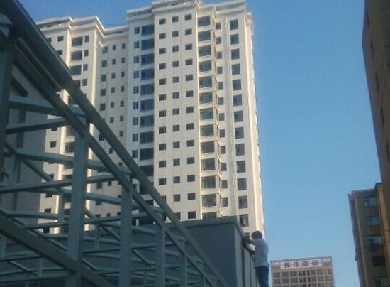 山西侯马建邦国际公寓外墙多彩仿石漆涂装工程